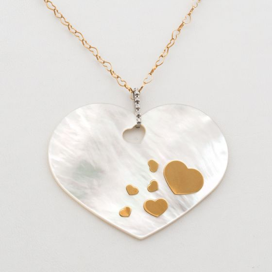Nanis white and yellow gold chain and mother of pearl pendant with diamonds