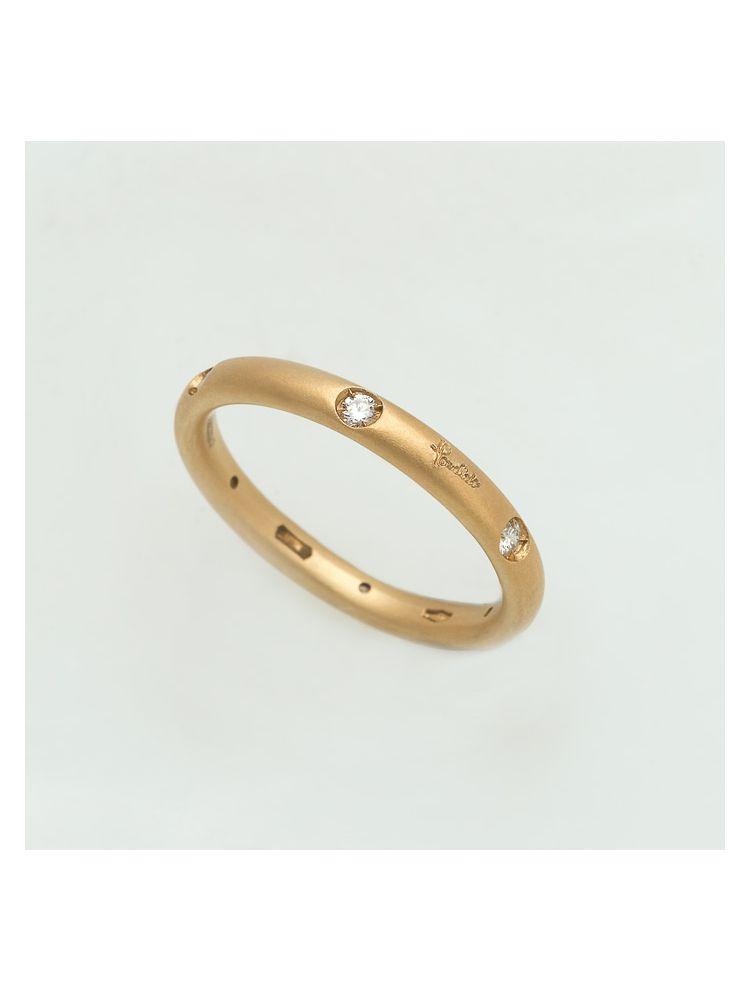 Pomellato yellow gold wedding band with diamonds